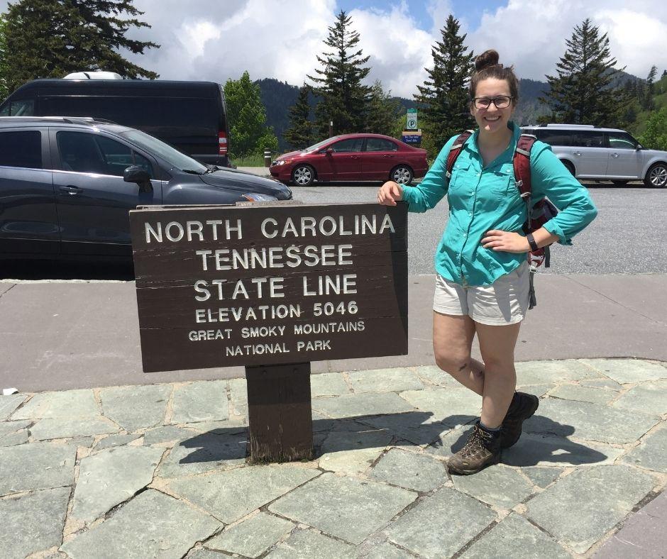 Sarah Sassoross in the outdoors near a sign - Alumni Spotlight: Sarah Sassorossi Class of '17 - Department of Forest Biomaterials NCState