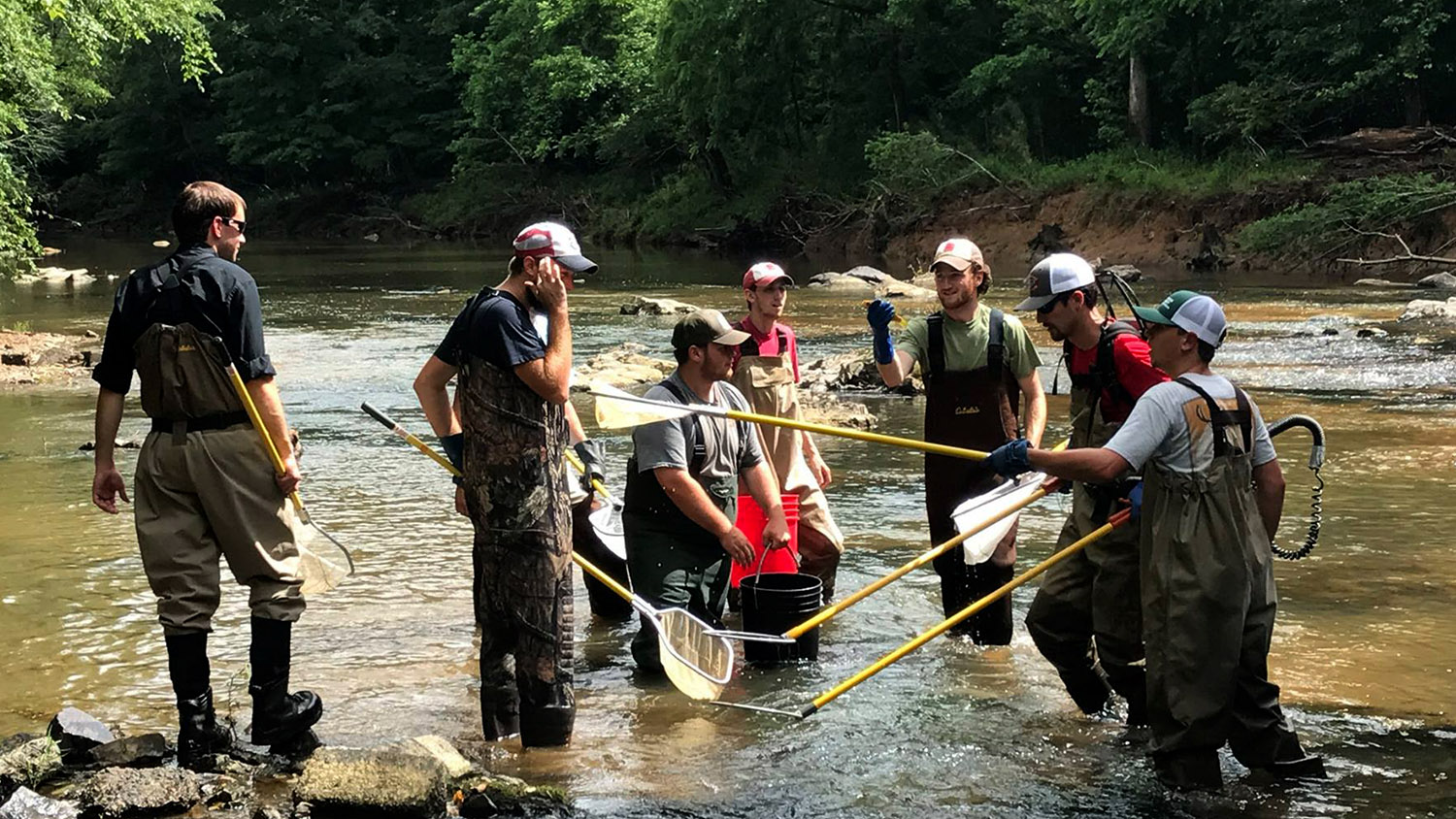 FWCB students in the field in a stream