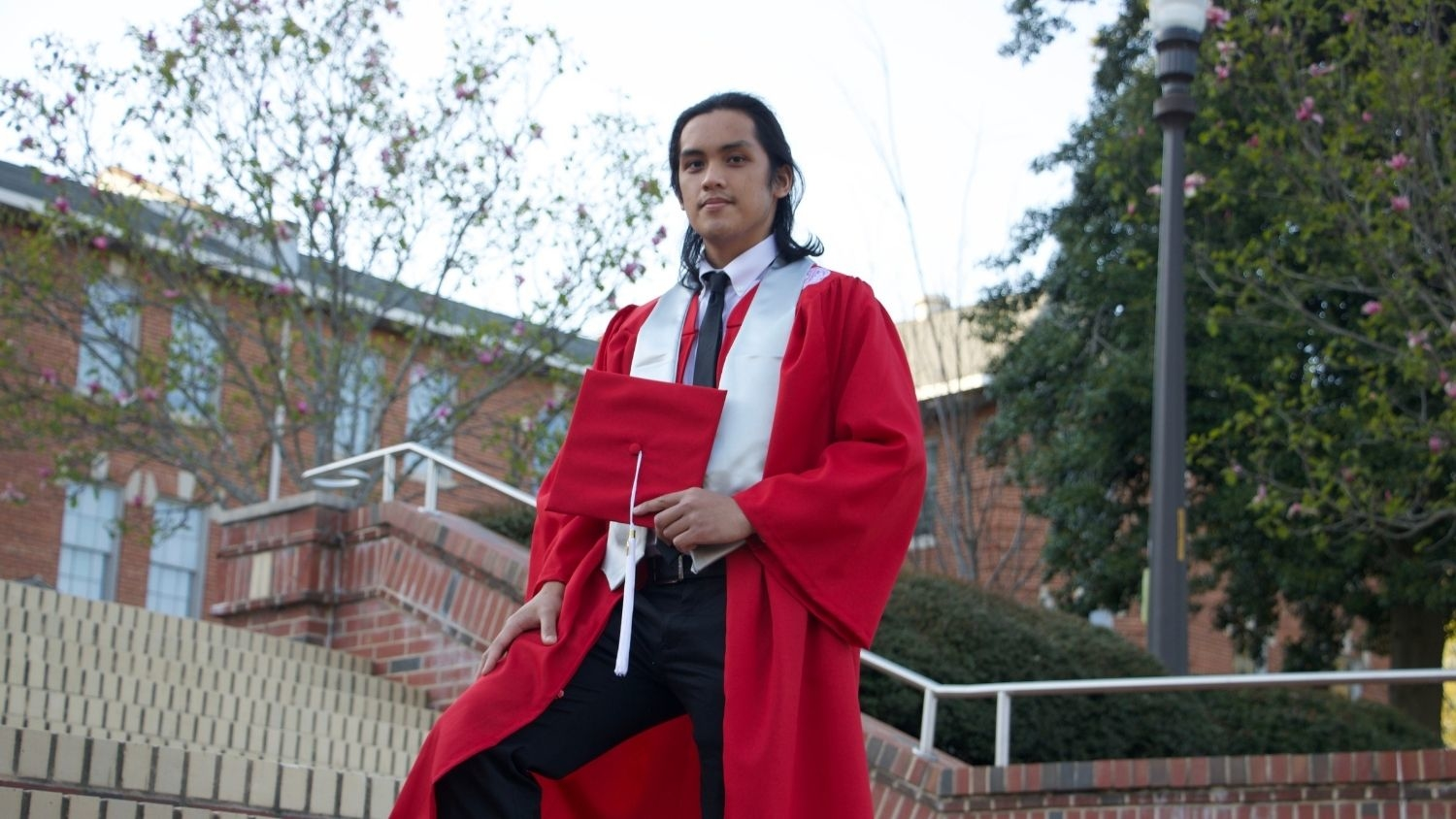 Joshua Pil in Cap and Gown - Graduation to Vocation: Supporting Rare Plant Species in North Carolina - Forestry and Environmental Resources Department at NCState
