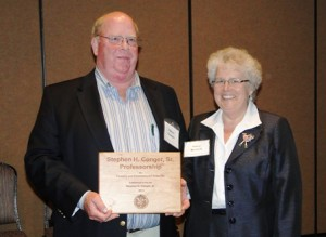 Steve Conger and Mary Watzin with Conger Professorship Plaque
