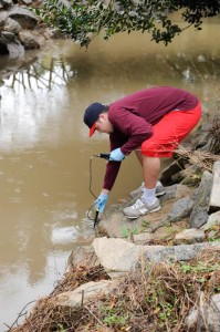 Environmental Technology and Management student testing the water quality.