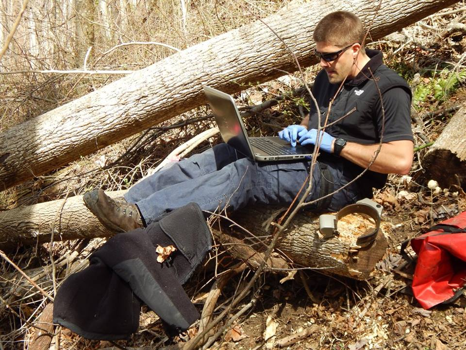 Doctoral student Nick Gould in the field