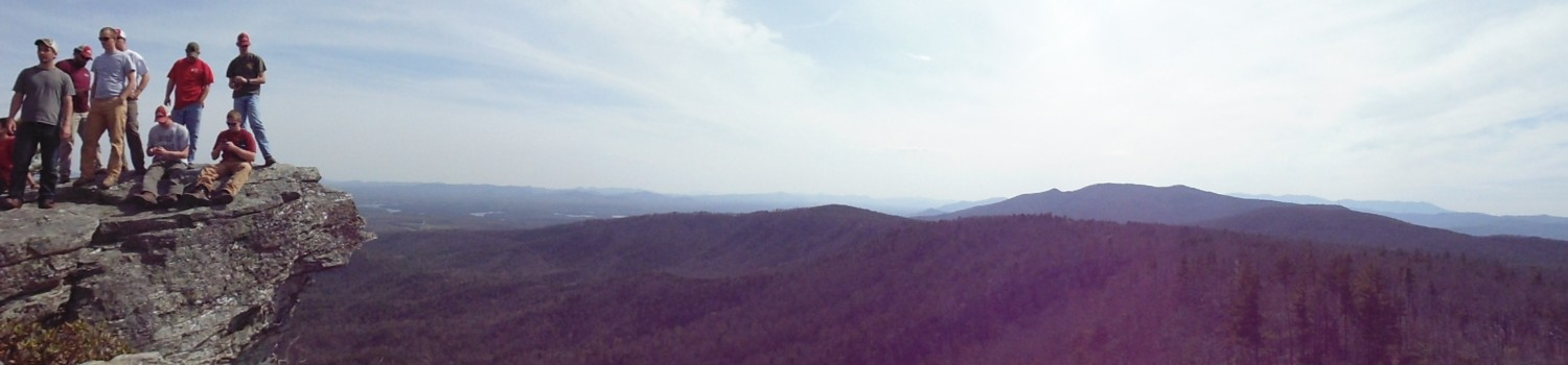 Panoramic view of blue ridge mountains with students on rock
