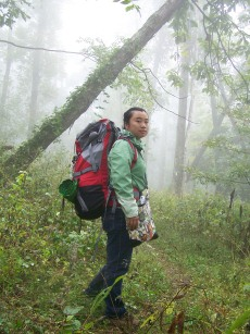 Wen Lin, PhD student, backpacking in the mist.