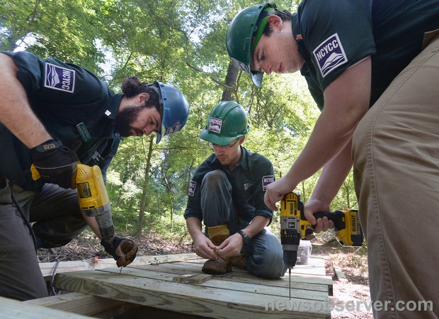 ETM senior Chris McGowan leads a crew constructing boardwalk along Ellerbe Creek.