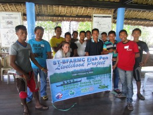 Tasha King with fishermen at a training for their livelihood project