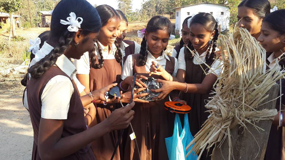 Students in India prepare their camera traps to monitor animals outside protected areas near their school.