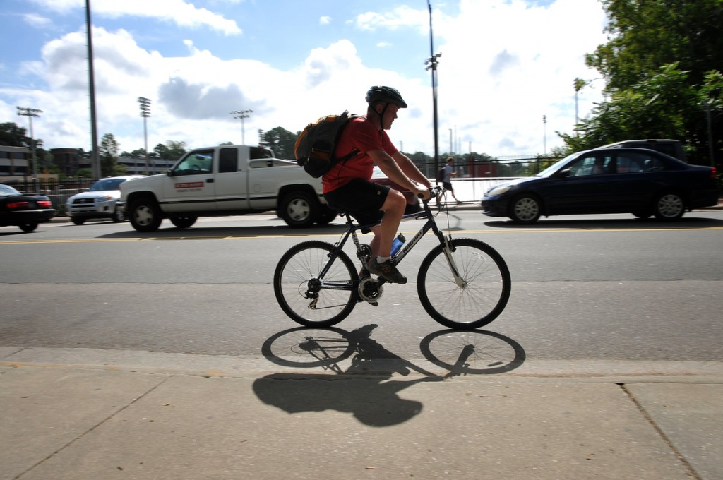 Bike rider heads South on Morrill Drive between between classes.