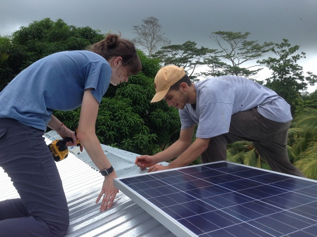 Installing a solar panel on a home in Manhattan, Nicaragua.