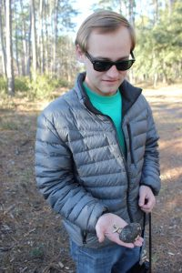 Author Noah Williams with an Eastern box turtle shell that he found while exploring Yawkey.