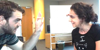 A photo of two Masters of Geospatial Information Science and Technology students using Google Glass at the North Carolina State University Center for Geospatial Analytics