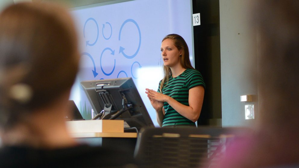 A photo of a woman giving a presentation at the North Carolina State University Center for Geospatial Analytics