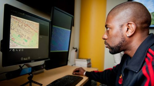 A student using a computer with eye tracking software at the North Carolina State University Center for Geospatial Analytics