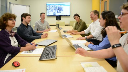 A photo of a meeting at the North Carolina State University Center for Geospatial Analytics