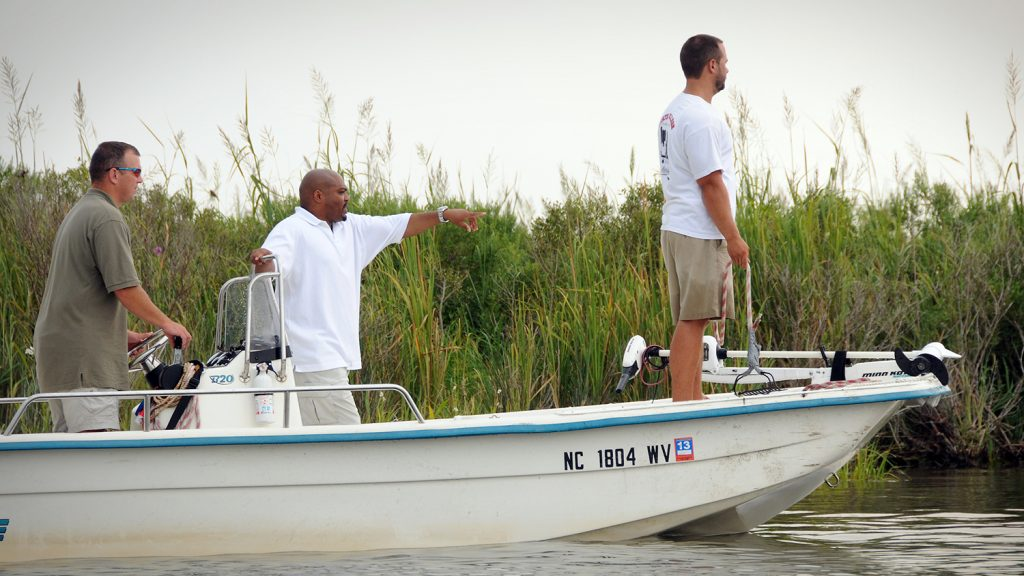 A photo of Stacy Nelson and students in a boat