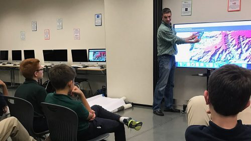 A photo of Justin Shedd giving a presentation to children visiting the North Carolina State University Center for Geospatial Analytics