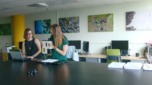 A photo of two women in the lab prep area at the North Carolina State University Center for Geospatial Analytics