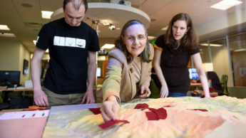 Helena works with two of her students on Tangible Landscape