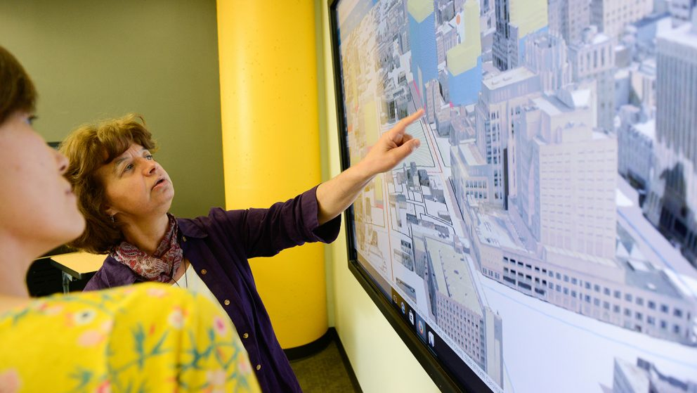 Dr. Perver Baran uses a touch screen to explain a 3D visualization project