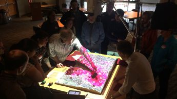 Stakeholders interact with a simulation of sudden oak death disease in Oregon