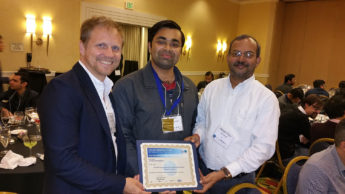 A photo of Ashwin Shashidharan standing with his advisors, Ross Meentemeyer and Raju Vatsavai, and holding an award at the ACM SIGSPATIAL Conference