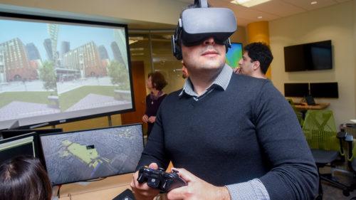 Payam Tabrizian wears a virtual reality headset