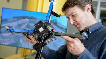 Josh Gray examines a drone