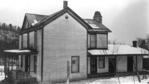 Black and white photo of an old house