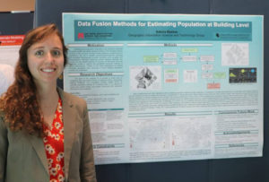 Sabina Bastias stands with her research poster