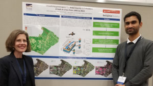 Carter Vickery and Vishnu Mahesh stand next to their poster at the NC GIS Conference