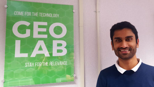 Vishnu Mahesh Vivek Nanda stands next to the GeoLab sign