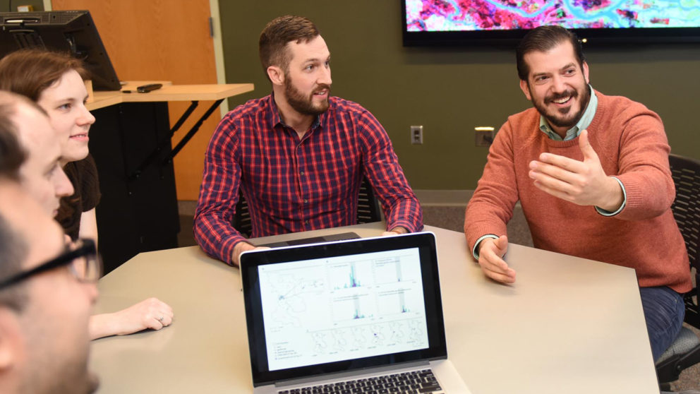 Jason Matney sits with fellow Center for Geospatial Analytics students