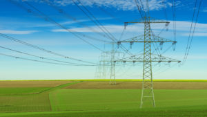 power lines cross an agricultural field
