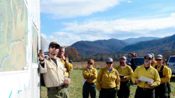Fire managers gather around a map before a prescribed fire in the Appalachians