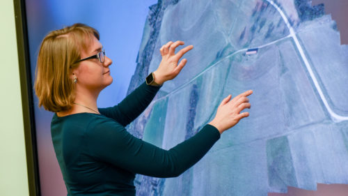 Justyna Jeziorska interacts with UAS data on a touchscreen