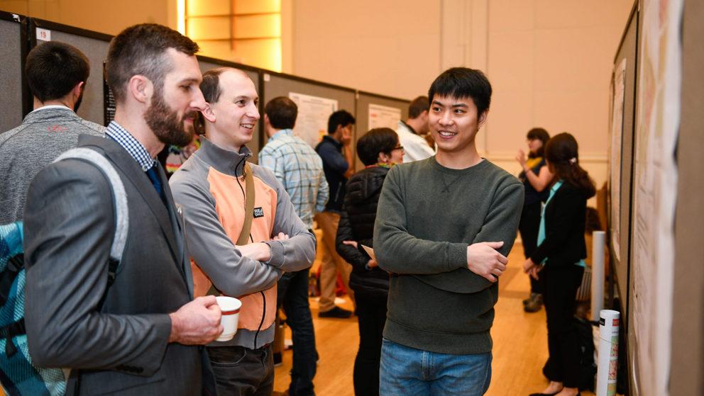 Nick Kruskamp, Vaclav Petras, and Zekun Lin at a research sysmposium