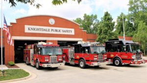 three firetrucks at a Knightdale fire station on a sunny day
