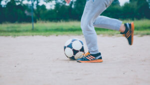 a youth prepares to kick a soccer ball