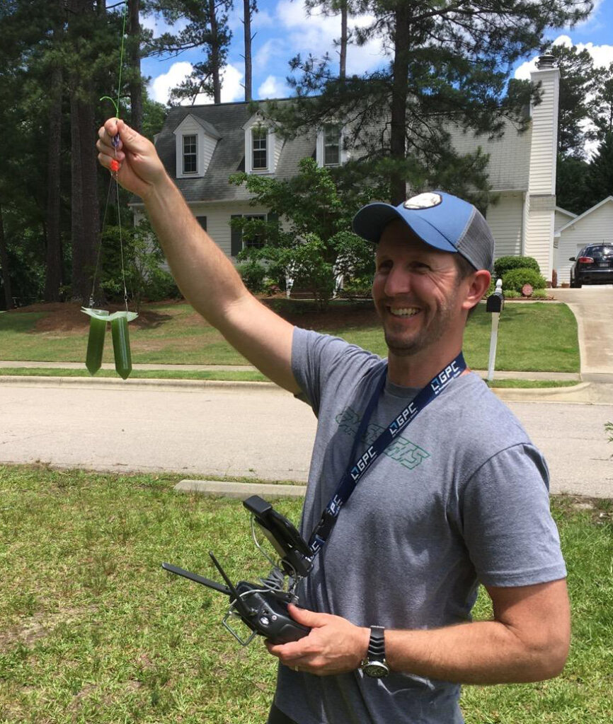 Will Reckling holds the water sampling rig he equipped a drone