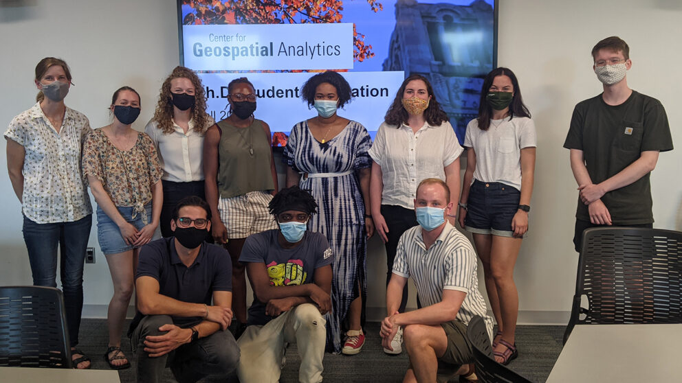 Students pose masked at Ph.D. orientation in Fall 2021