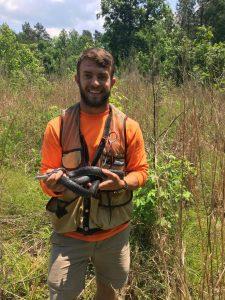 Dillon Dunn holding a snake