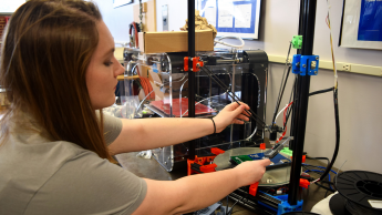 SMT student with 3-D printer