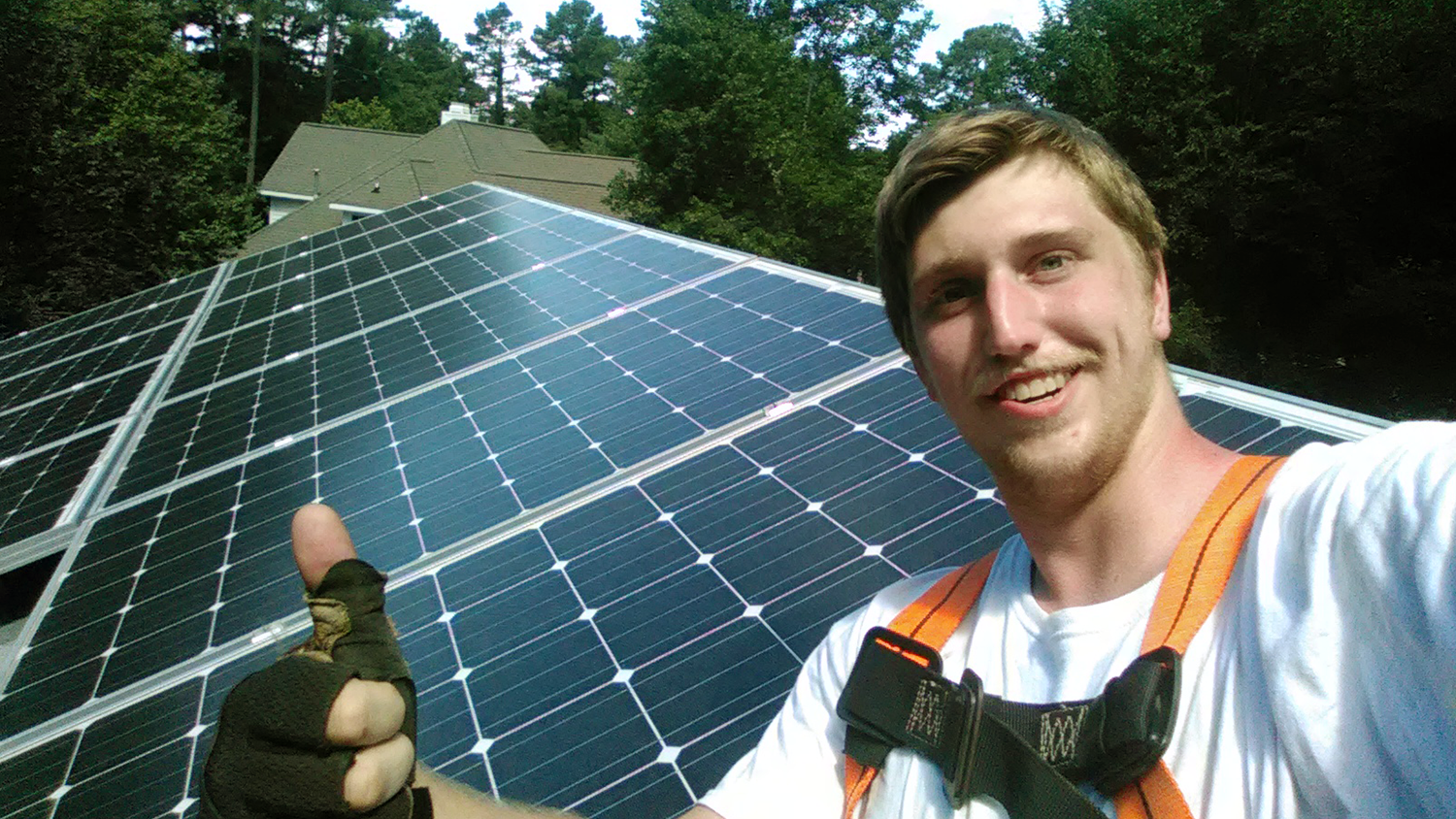 Jack Marley, Sustainable Materials and Technology major, installing solar panels