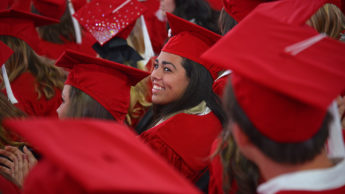 Happy students at commencement in PNC Arena.