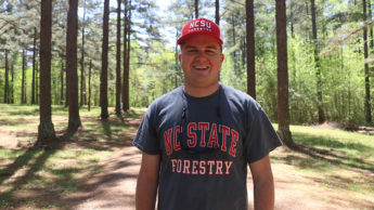 Student hikes outside in woods