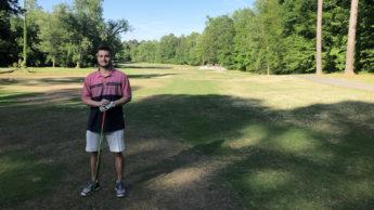 Student golfing