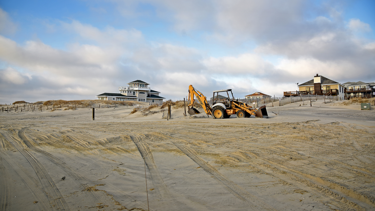 Sand gets moved around to protect further dune erosion along the beach at Carova.