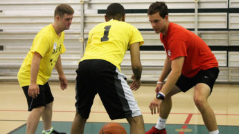 Student coaching players with special needs in basketball
