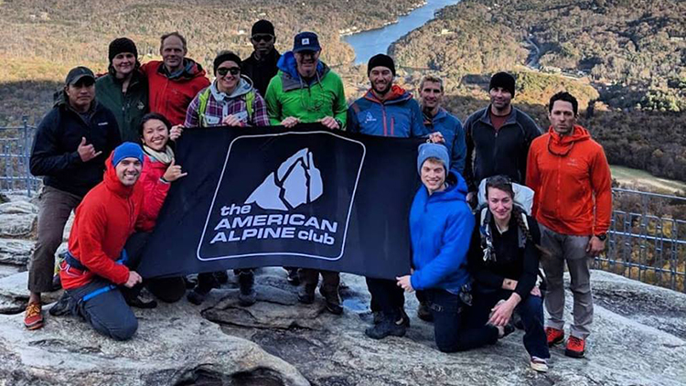 American Alpine Group poses for photo