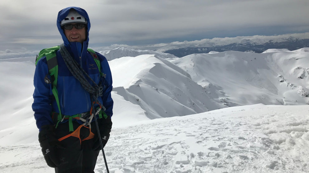 Student poses while climbing in Denali